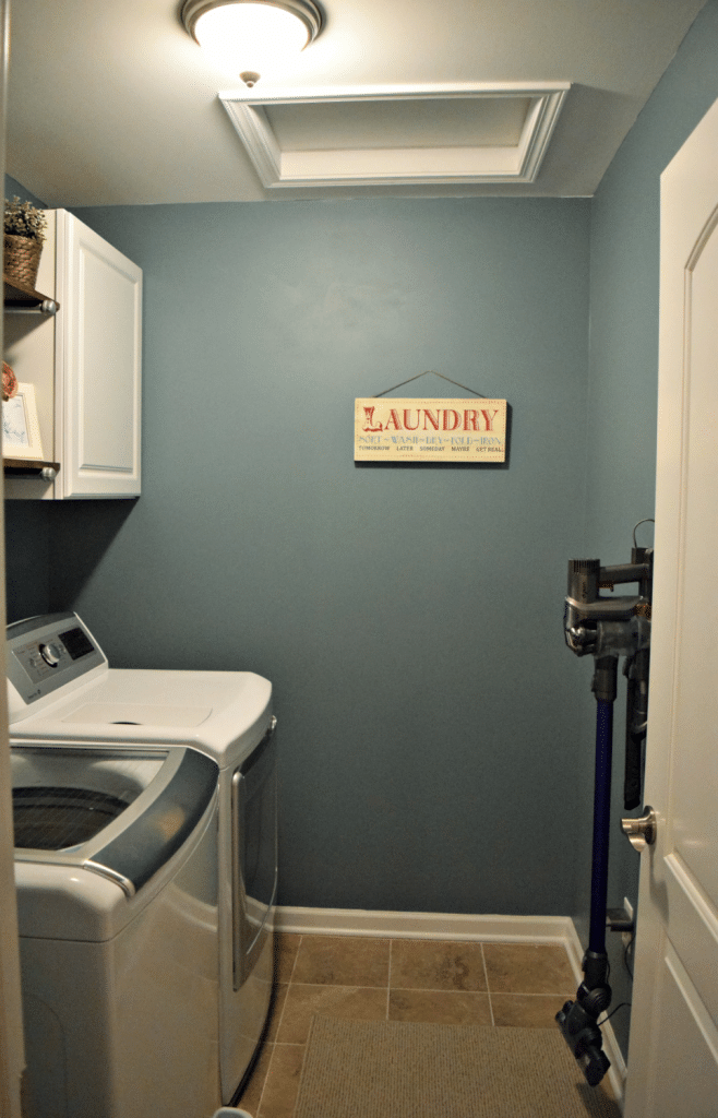 Our updated laundry room decor makes the room feel so much bigger and brighter!