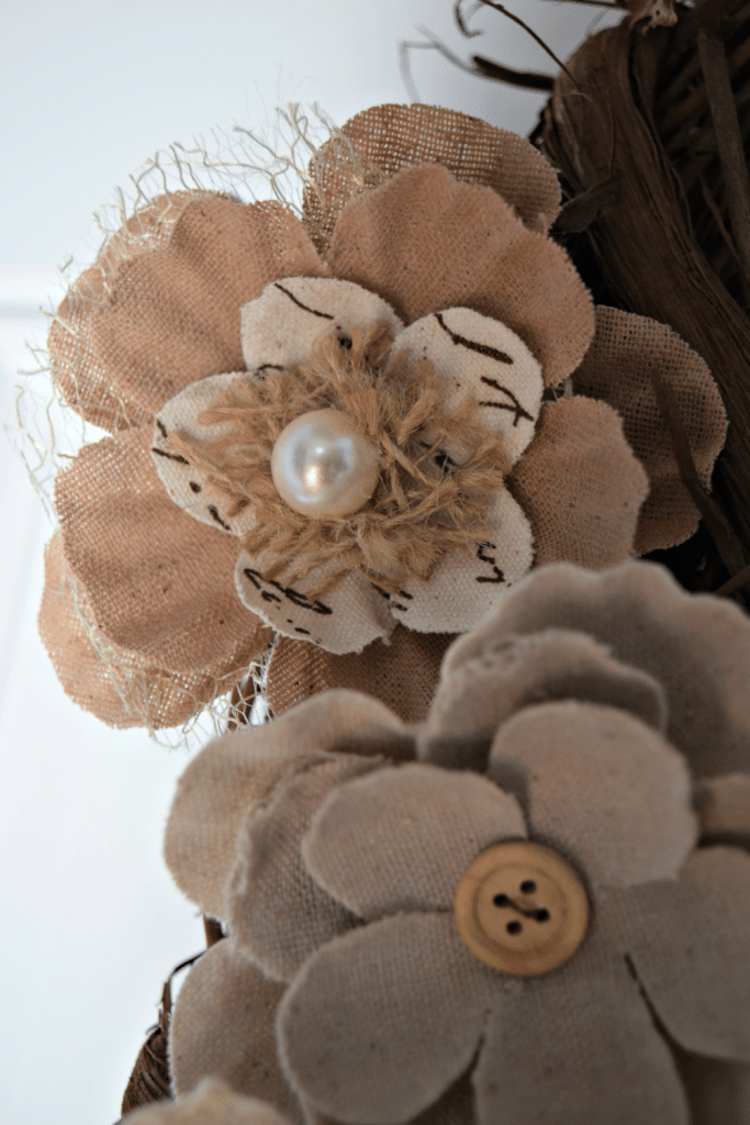 These rustic burlap flowers are beautiful with unique touches like pearls and buttons