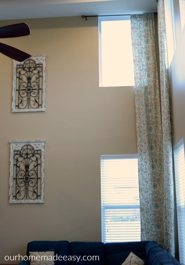 An easy tutorial on making your own two story curtain panels! Easy & Quick to make