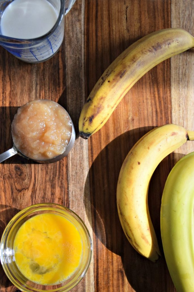 Ingredients for a healthy, flavorful banana bread include bananas, applesauce, milk and eggs