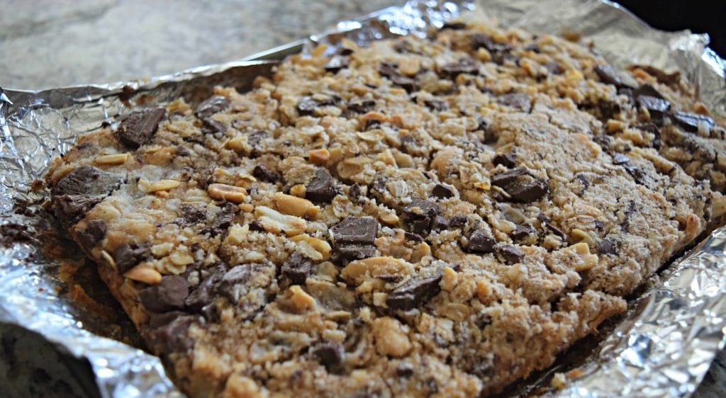 Peanut Butter & Chocolate Chunk bars! Perfect for a salty and sweet treat! Click to see the recipe!