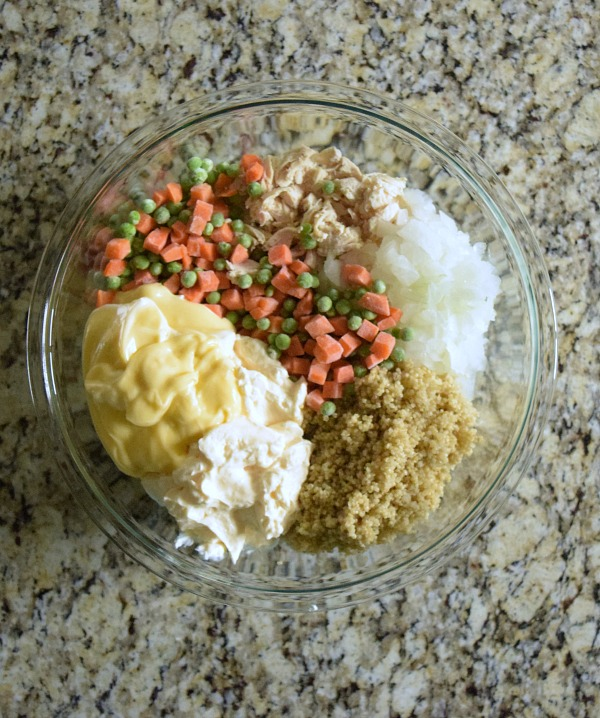 Mix the casserole ingredients together in a large glass bowl. You'll need fresh or frozen carrots and peas, onions, quinoa, and chicken