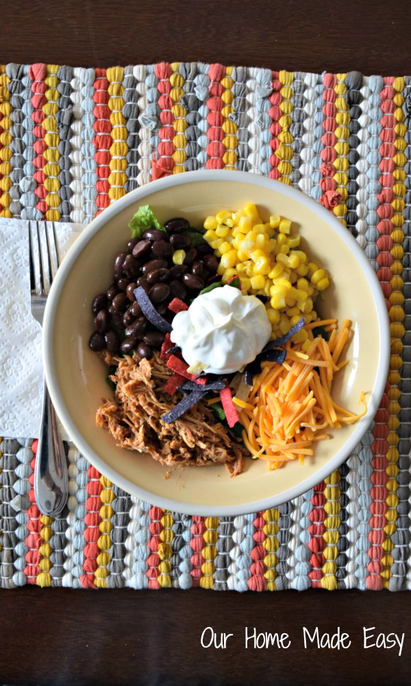 Tender chicken, beans, corn, cheese and sour cream in a bowl