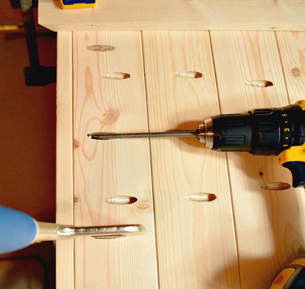 Drilling screws into the wood boards for your DIY wood serving tray