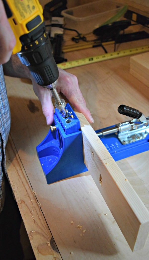 Use a guide to drill the pocket holes into the wood for your DIY wood tray