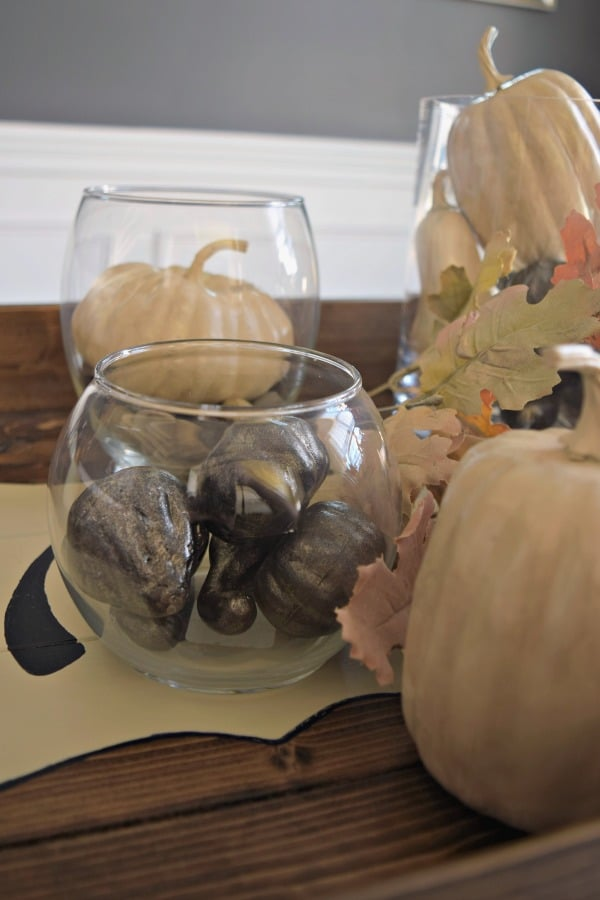 Recreate Pottery Barn pumpkin fillers with Dollar Store pumpkins painted in pretty fall colors