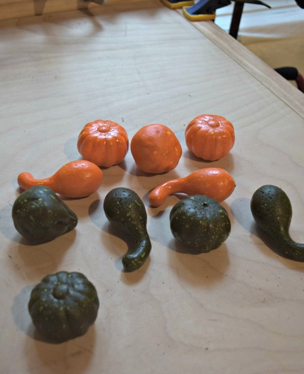 Dollar Store pumpkins and gourds can be painted and used for knock off Pottery Barn pumpkin fillers