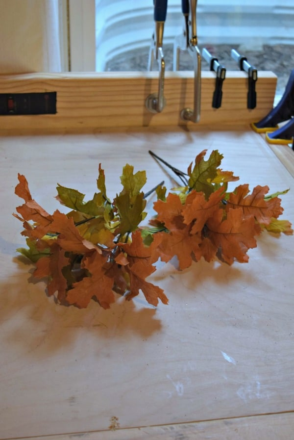Using fall leaf arrangements from the dollar store is a perfect addition to any fall centerpiece