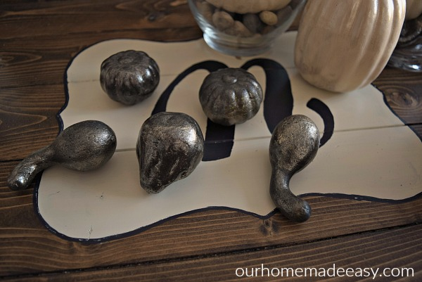 I painted these dollar store pumpkins and gourds with a metallic silver spray paint