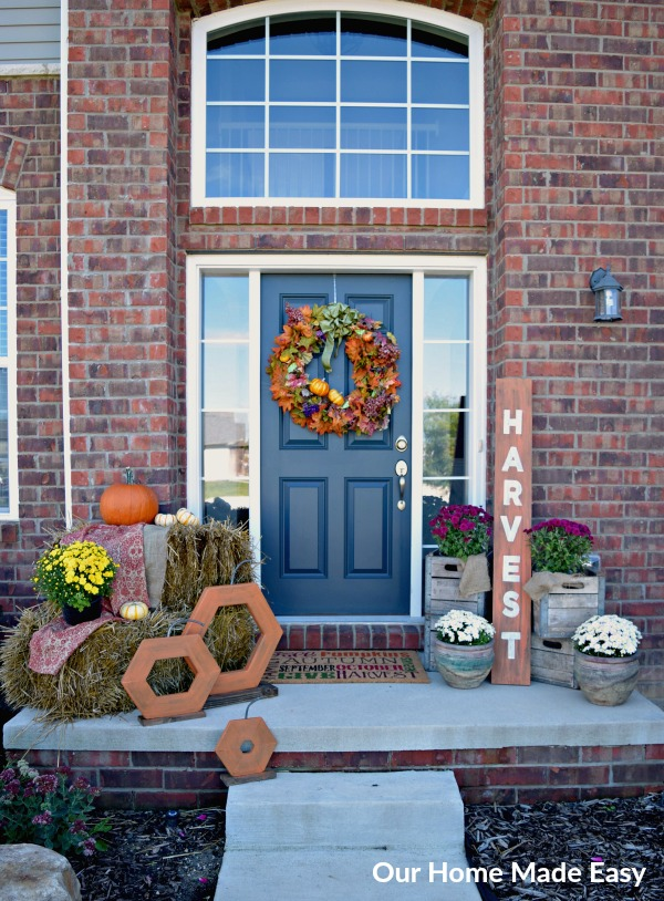 This Fall front porch is filled with fun DIY projects that are so easy to make