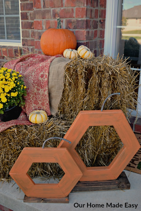 These DIY wood pumpkins were a simple afternoon project that looks great on our fall front porch