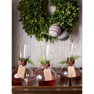 A Boxwood wreath adds a fresh green touch to your Christmas decor