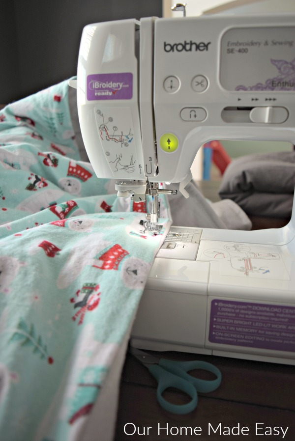 Top stitch your diy flannel blanket, creating a seam that seals the two layers of flannel and batton