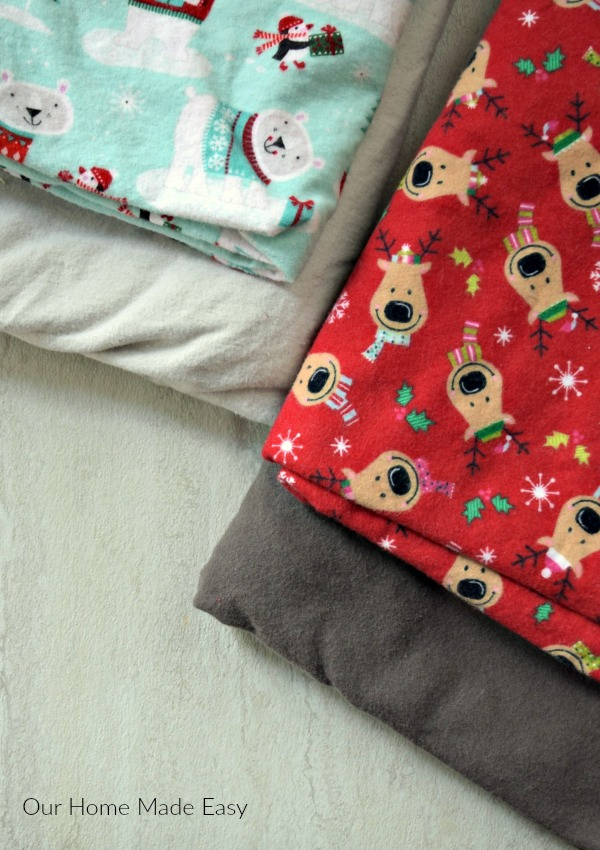 We made these cozy diy flannel blankets right around the holidays, so we used fun Christmas flannel fabric