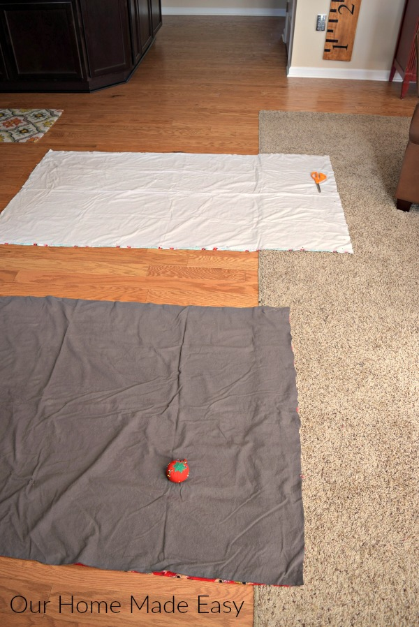 Lay out the flannel fabric on the floor (or other surface with enough space) to trim and cut the fabric to the correct lengths