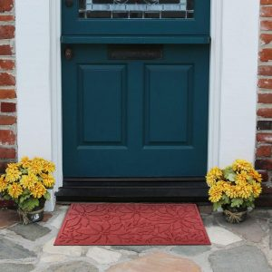 A simple red snowflake door mat is a subtle festive welcome to your home