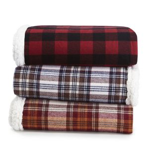 These red, white, blue, and green flannel throw blankets are warm and festive