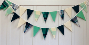 This green plaid Christmas banner is subtle festive decor for Christmas
