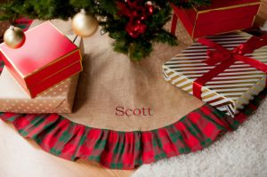 This holiday plaid tree skirt can be customized with all your family names