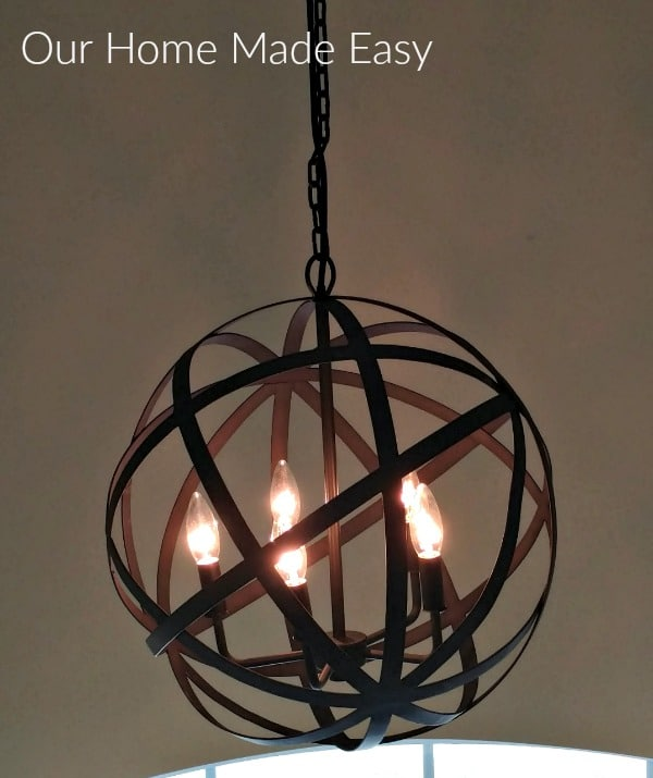 This farmhouse style foyer chandelier is a metal orb with rich lighting that looks great in our home