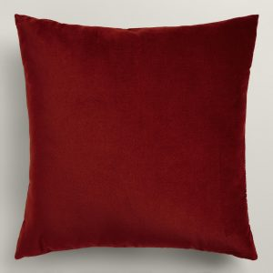 A classic red velvet throw pillow is a simple way to add a Christmas touch