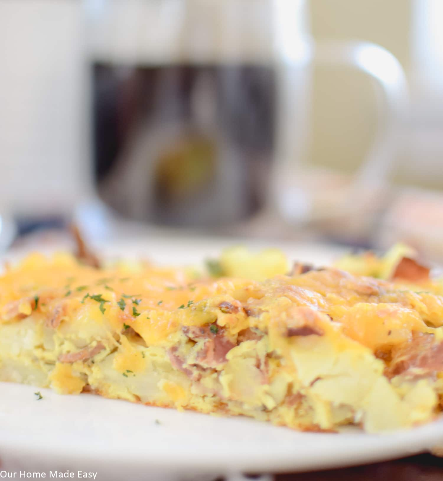 layers of cheese and fluffy eggs with bacon and sausage is a simple breakfast casserole