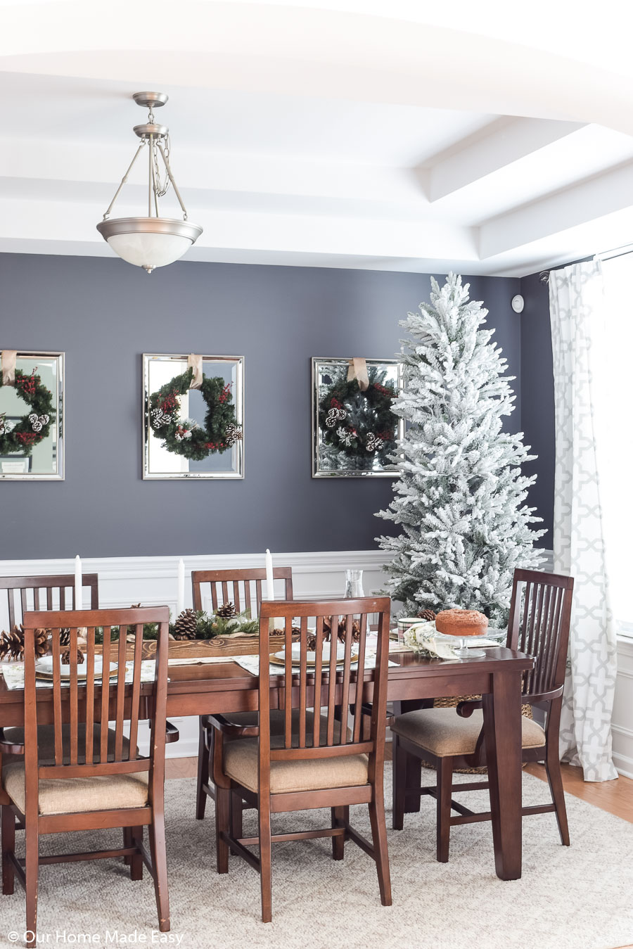 The simplicity if our Christmas dining room decor is bright and festive