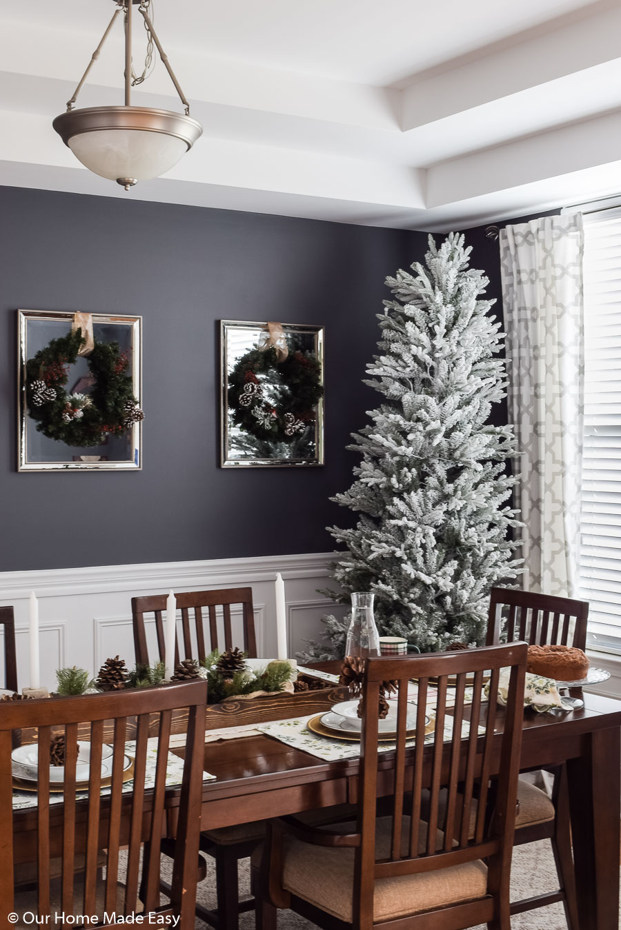 Our bright Christmas dining room has simple Christmas decor that brightens up the room