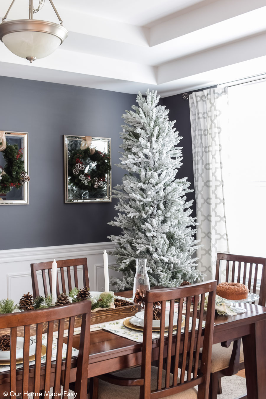 Our Christmas dining room is simple and clean. We love our white frosted branch Christmas tree!