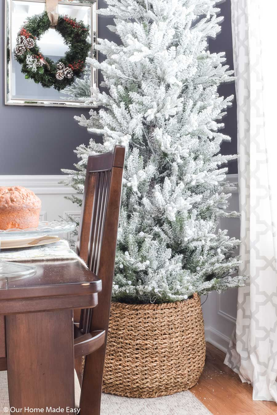 "Our faux ""flocked"" Christmas tree is so simple, it didn't need any additional decor!"