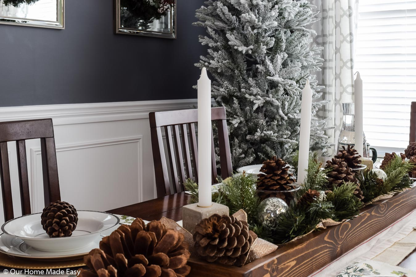 Candlesticks are a perfect addition to our Christmas dining room table centerpiece