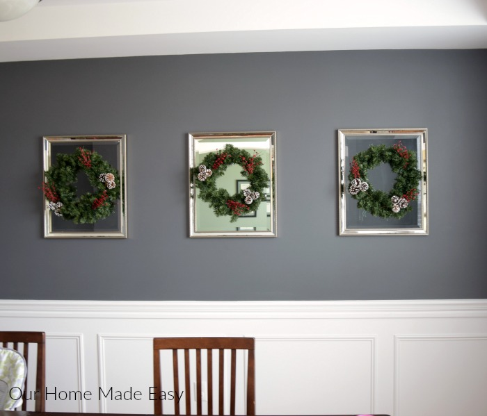 I hung each of my DIY Christmas wreaths on a mirror in our dining room