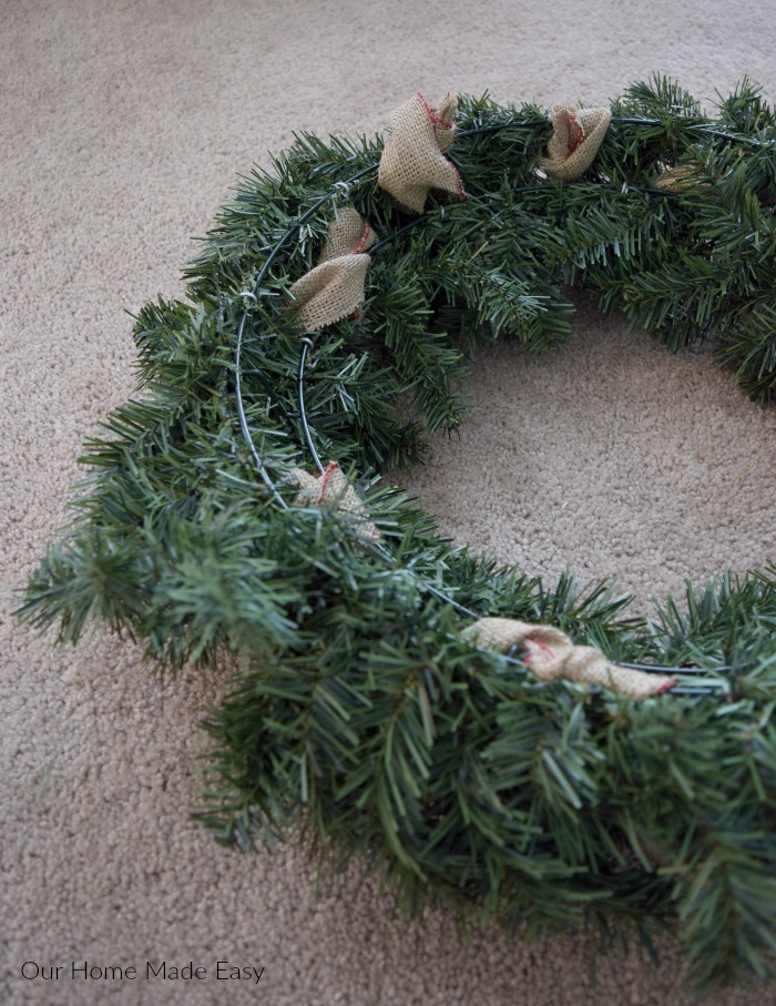 This is what the wreath looks like from the back, with burlap ribbon woven through the branches