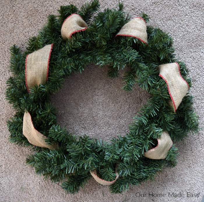 Weave the ribbon throughout your Christmas wreath