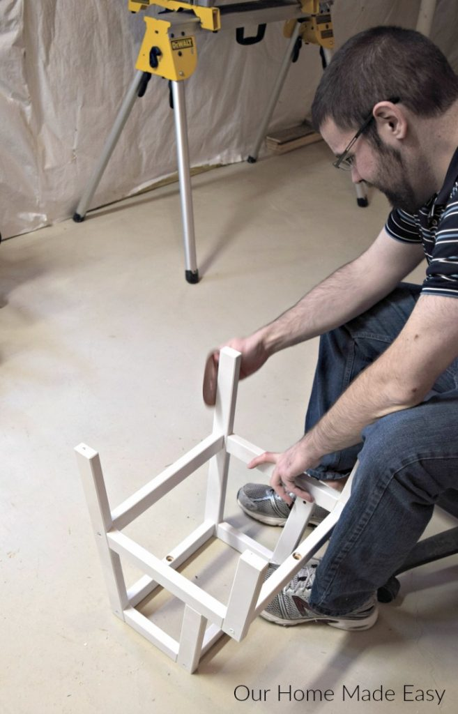 Jordan sanded down the ikea bekvam step stool legs between each coat of paint for a smooth finish