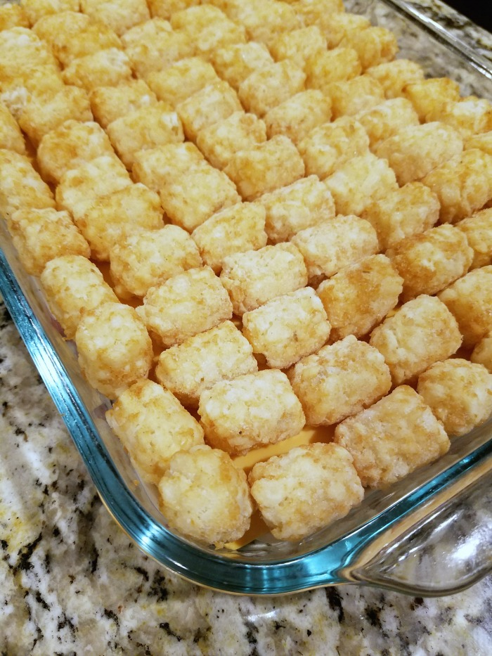 I love lining up the frozen tater tots in neat little rows--it just makes this easy tater tot casserole look so delicious and pretty!