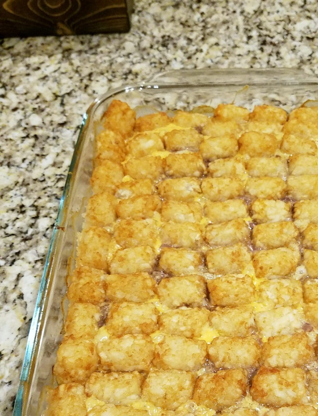This easy tater tot casserole just calls for three main ingredients--tater tots, ground beef, and cheese! Customize it with your favorite add-ins