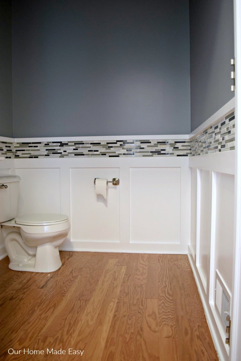 Here is how we easily added accent mosaic tile around our powder room! It made such a huge difference, and it was an easy DIY. Check out the AFTER!