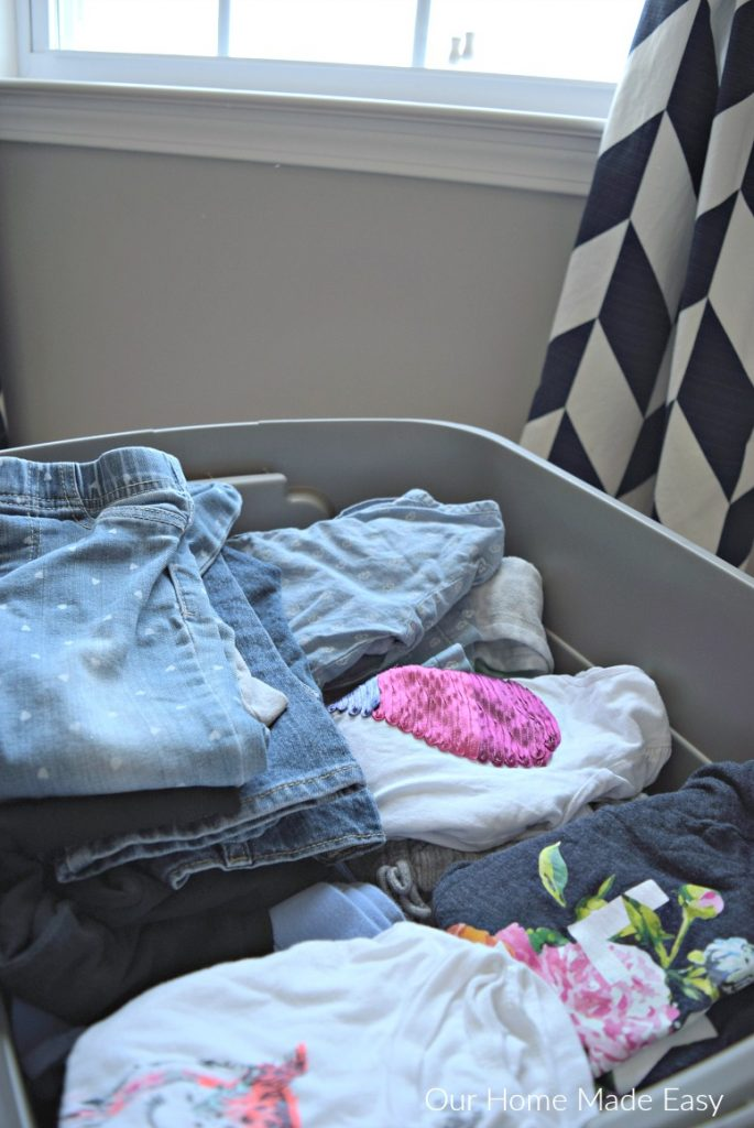 Keep empty totes in your kids' rooms and fill them with clothes that they no longer wear or fit
