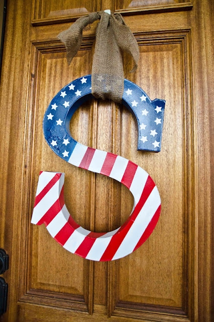 spruce up your front door with some patriotic flair with this red, white, and blue letter