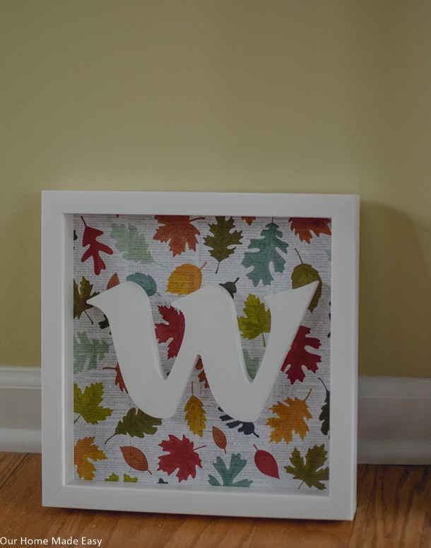 This cute DIY shadowbox is perfect for fall and you can change out the paper for every season! You can love it all year long. Click to see the steps!