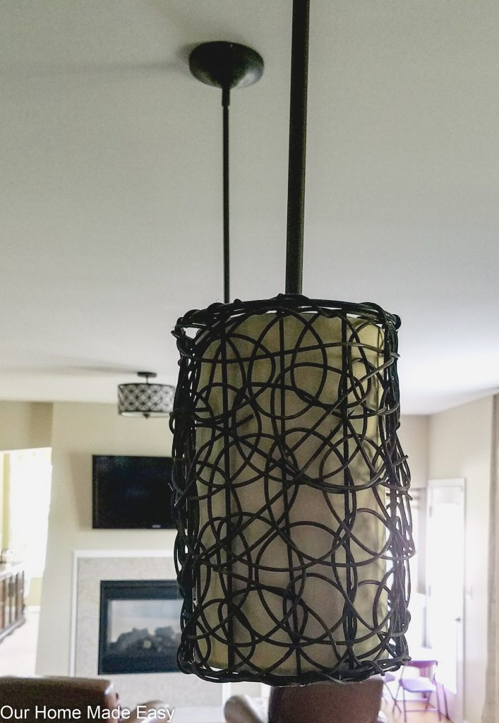 Our old kitchen island pendant lighting was dark and didn't fit with the rest of our kitchen design