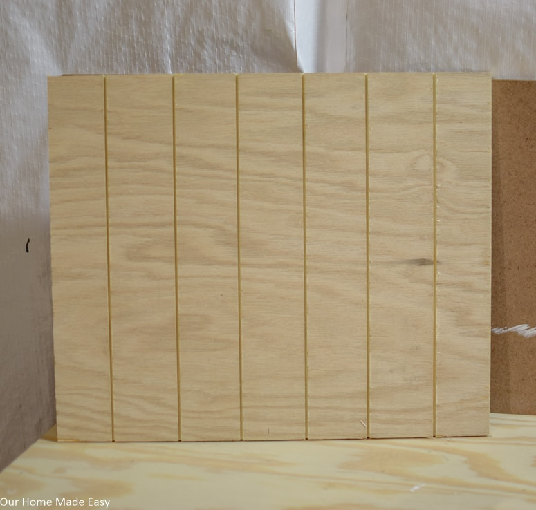 Use a table saw to cut grooves into the plywood to resemble grooves in the surface of a pumpkin