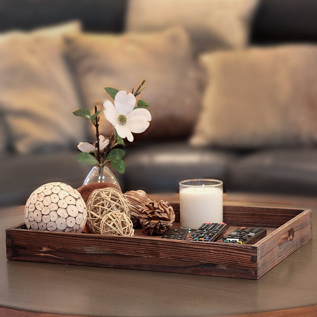 This wooden centerpiece tray is a great farmhouse style accent piece for your home