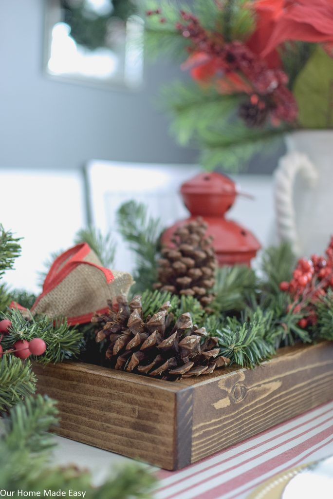 This DIY wood tray is perfect to use as a decorative centerpiece for holiday decorating