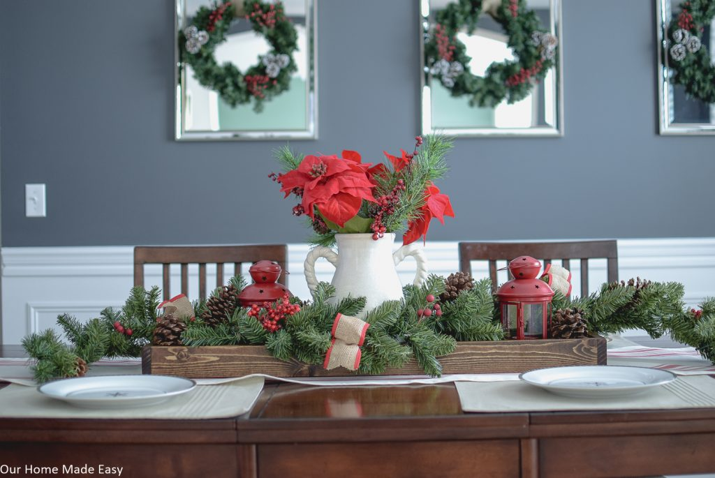 This DIY wood serving tray makes a perfect centerpiece for our Christmas table