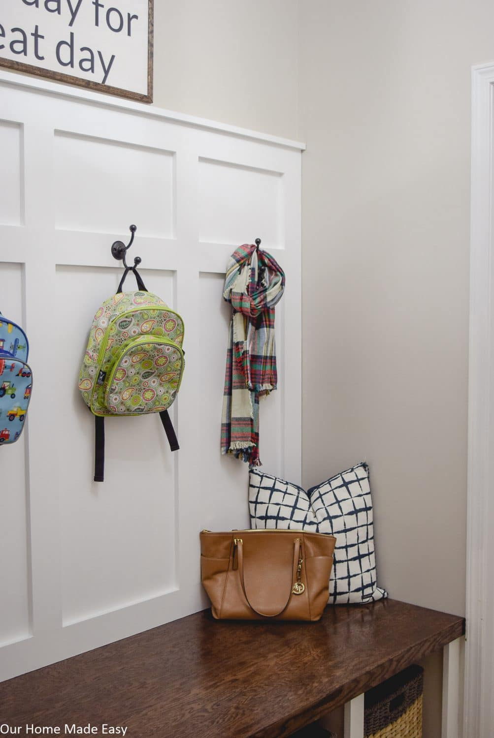 The color scheme in our mudroom and entry way is light beige, to keep the room feeling open and bright