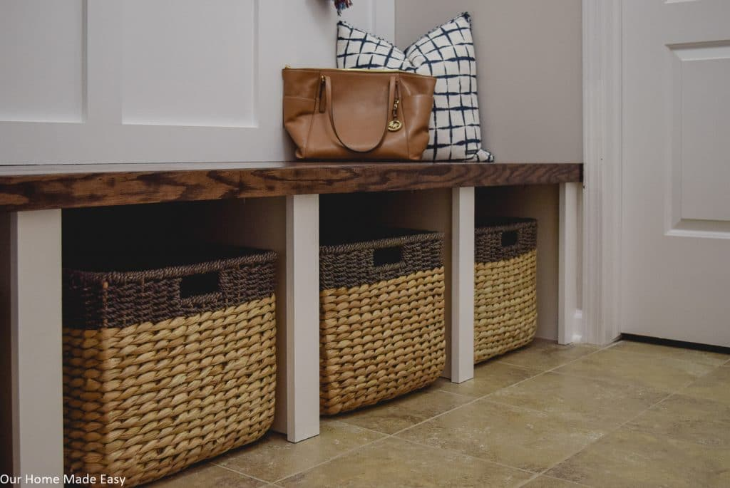 Toss the catch-all clutter into baskets for more efficient storage in a small space
