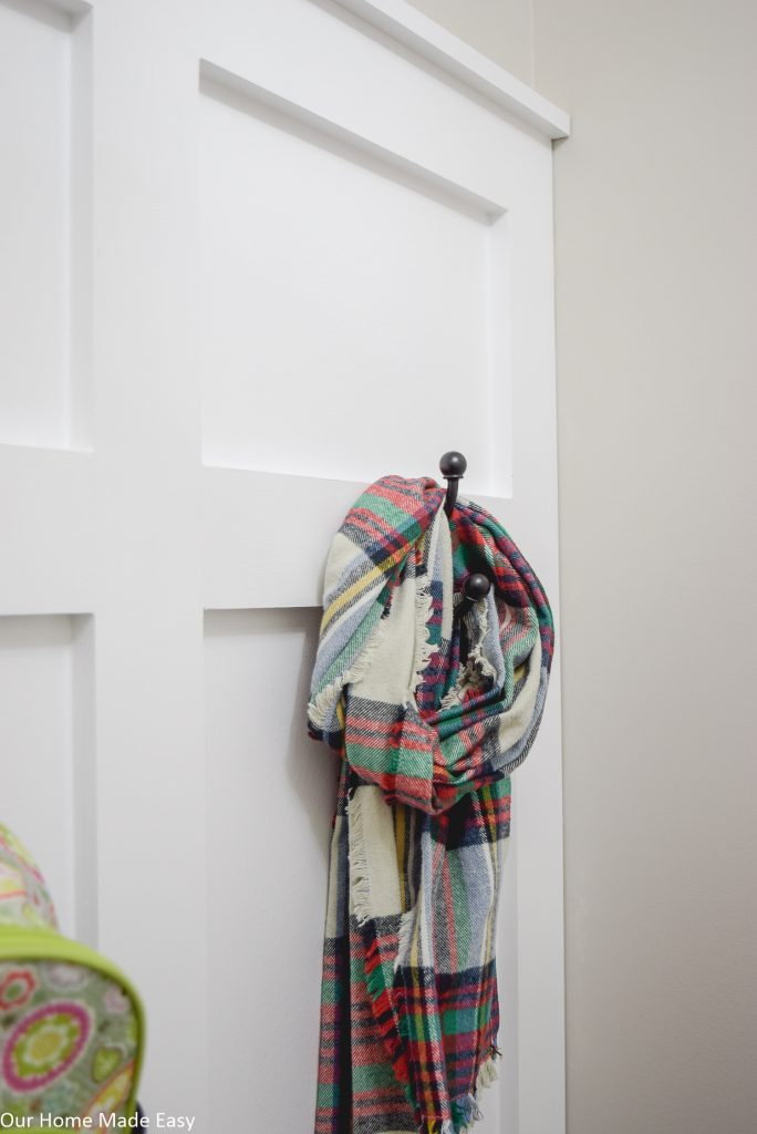 Coat hooks make it easy to keep scarves and jackets off the floor