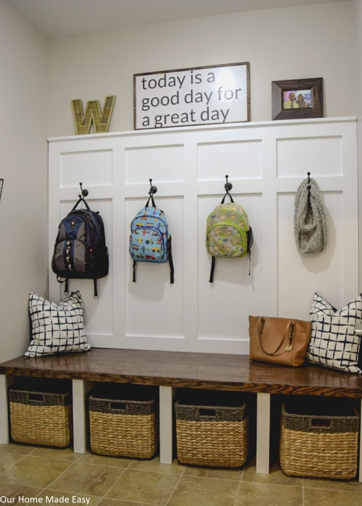 DIY your own mudroom makeover with these easy projects! Click over to see how a new home build mudroom turned into custom built-ins!